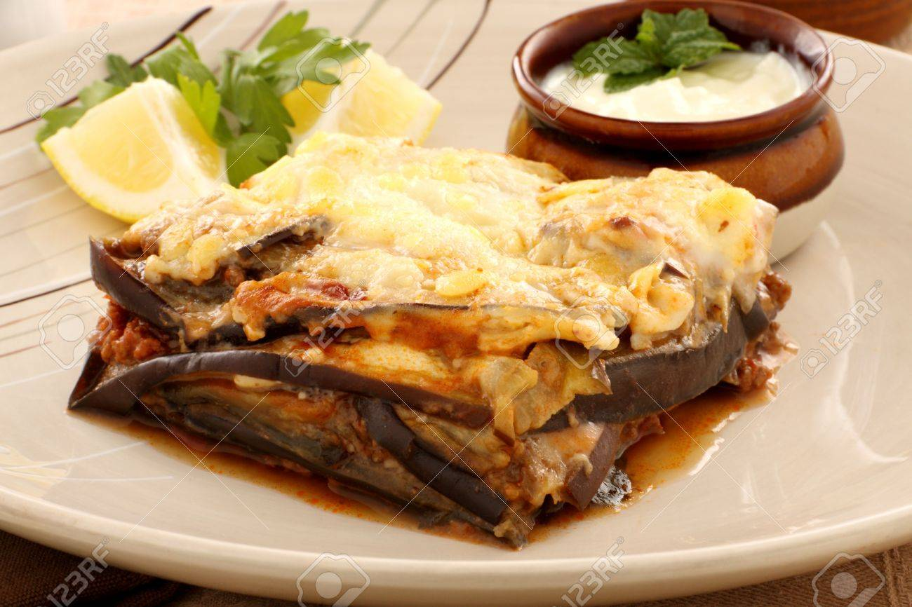 Delicious Greek moussaka with aubergine and a side garden salad. - 9004407