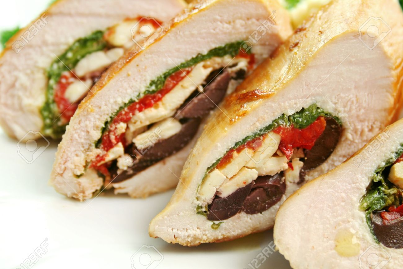 Chicken stuffed with a Mediterranean filling made of spinach, fetta, peppers and olives with vegetables. - 18289154
