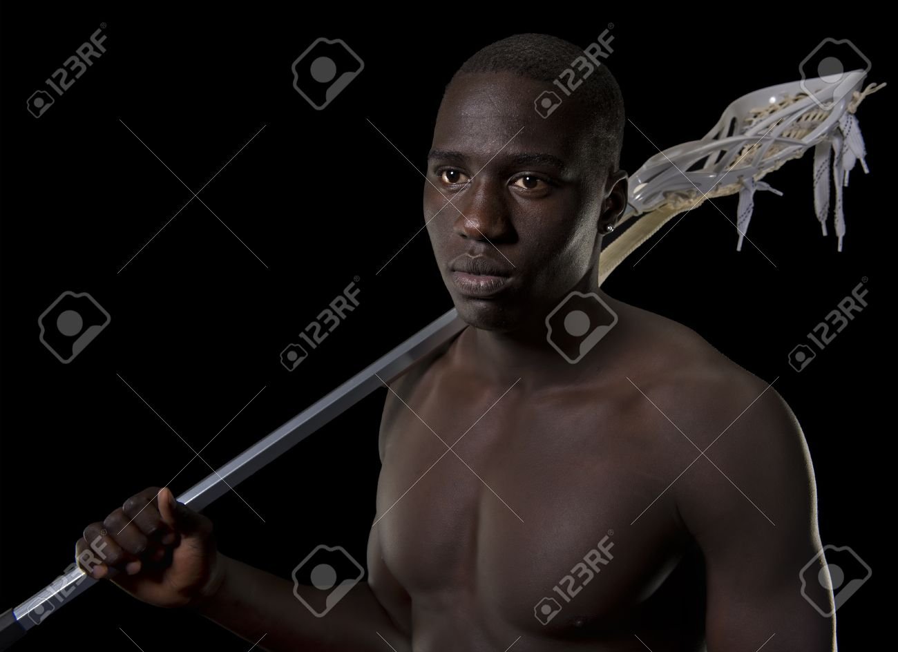 Black lacrosse player with his stick over his shoulder Stock Photo - 16077964
