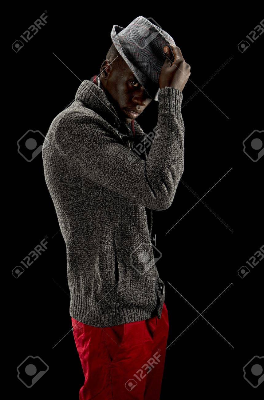 Black man removing his hat Stock Photo - 16085417