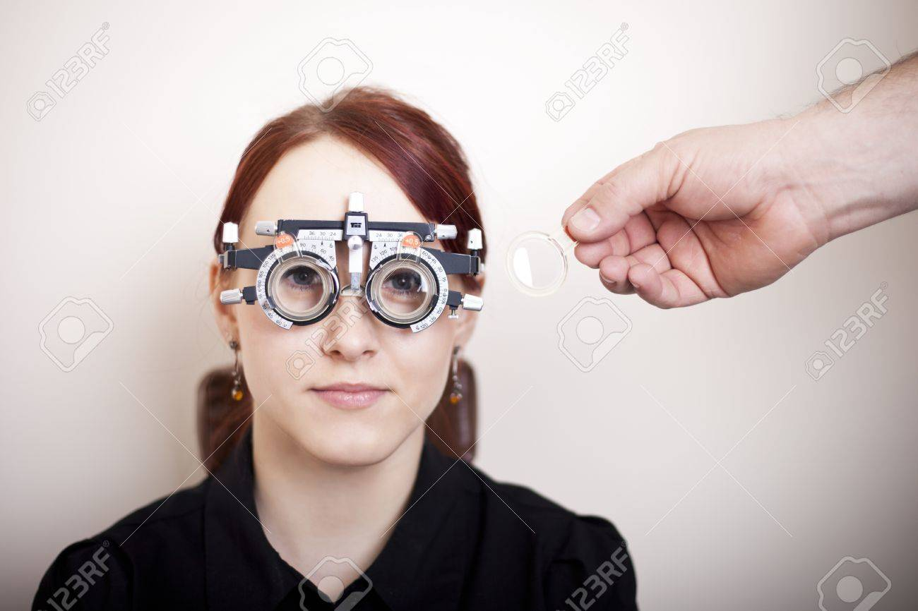 9ed4c8e9d3d0 Beautiful young woman having eye test At the optometrist concept Stock  Photo - 13088370