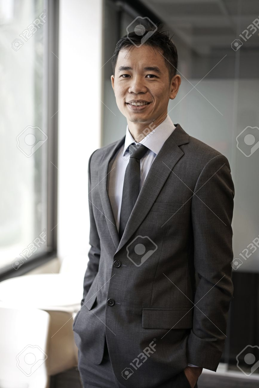 picture of an successfull asian business male in corporate attire