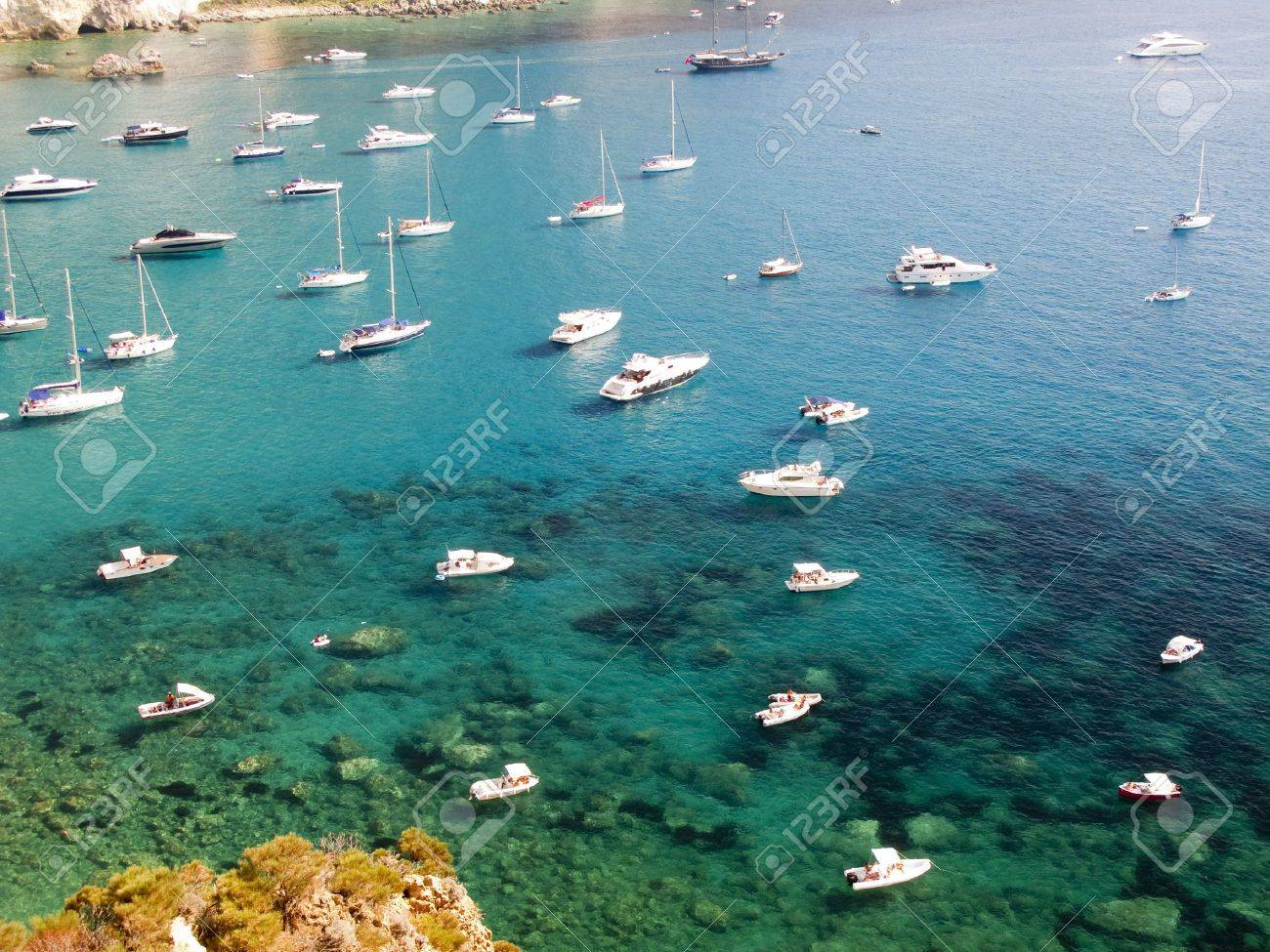 Aerial view of the coastline of Ponza, Italy.  Sailboats anchored along the water Stock Photo - 11266832