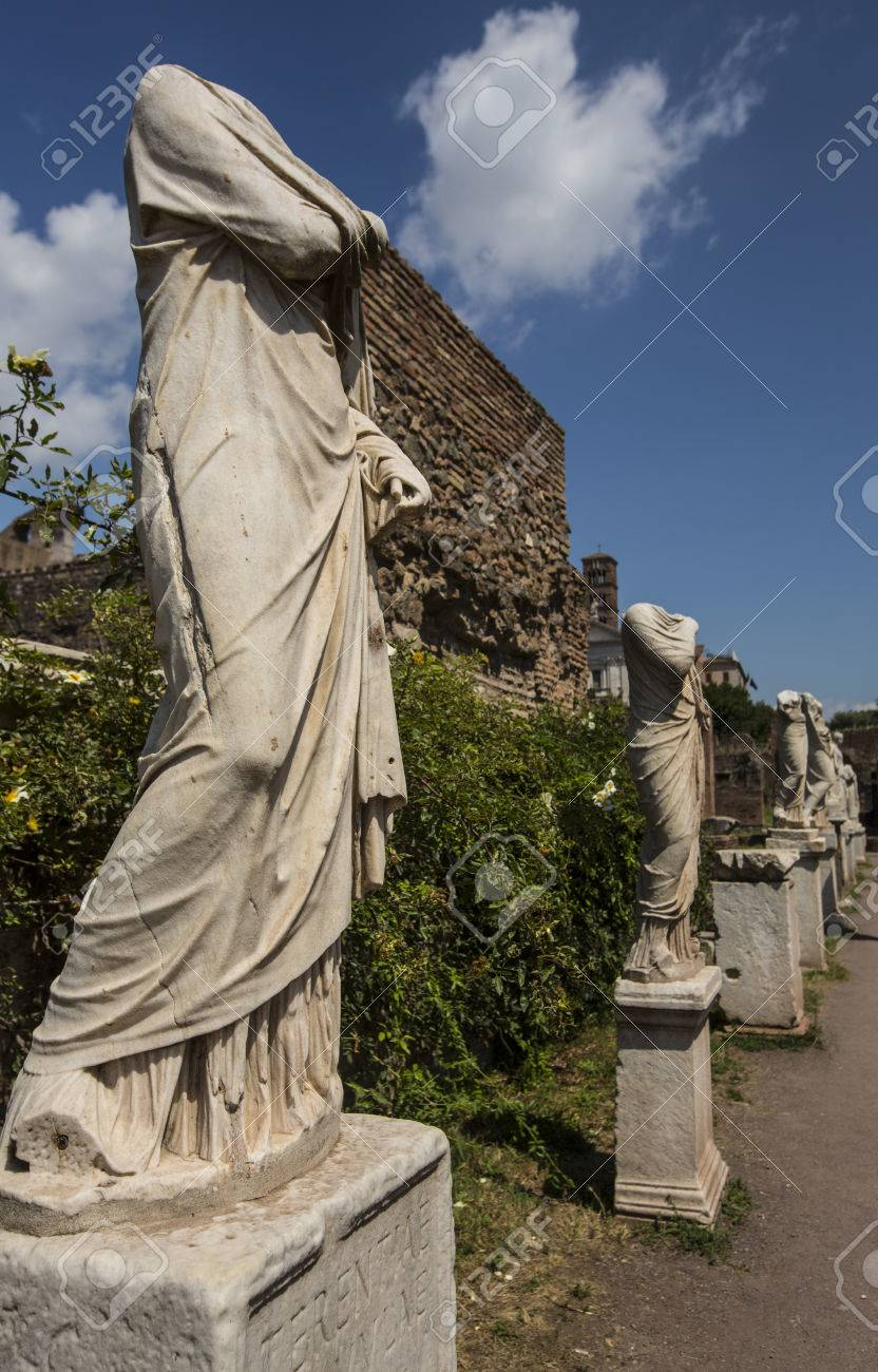 Row of headless marble statues in Roman Forum Stock Photo - 31605369