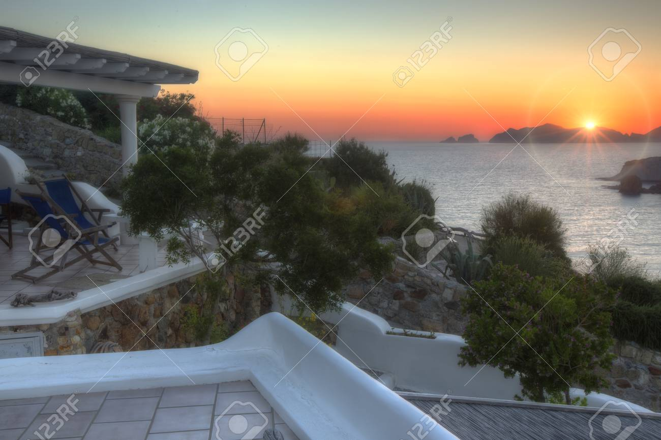 Sunset over a private villa on a tropical island Stock Photo - 33447906