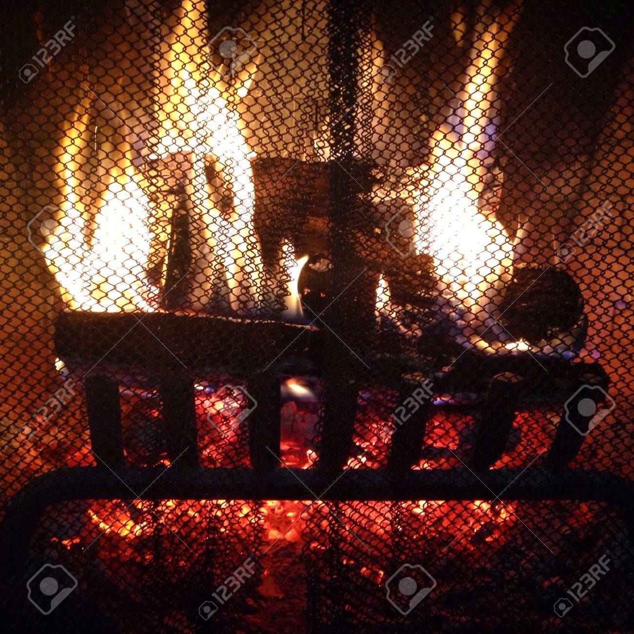 Burning logs in a fireplace Stock Photo - 34068094