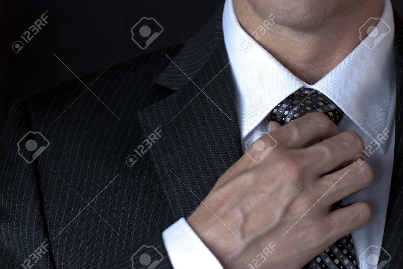 Businessman Adjusting Tie Stock Photo - 8770928