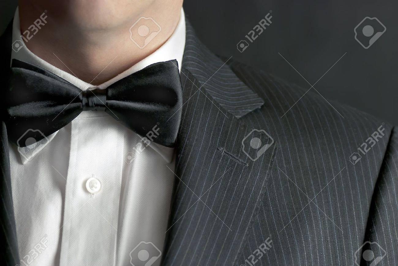 A close-up shot of a man wearing a tux. - 8954966