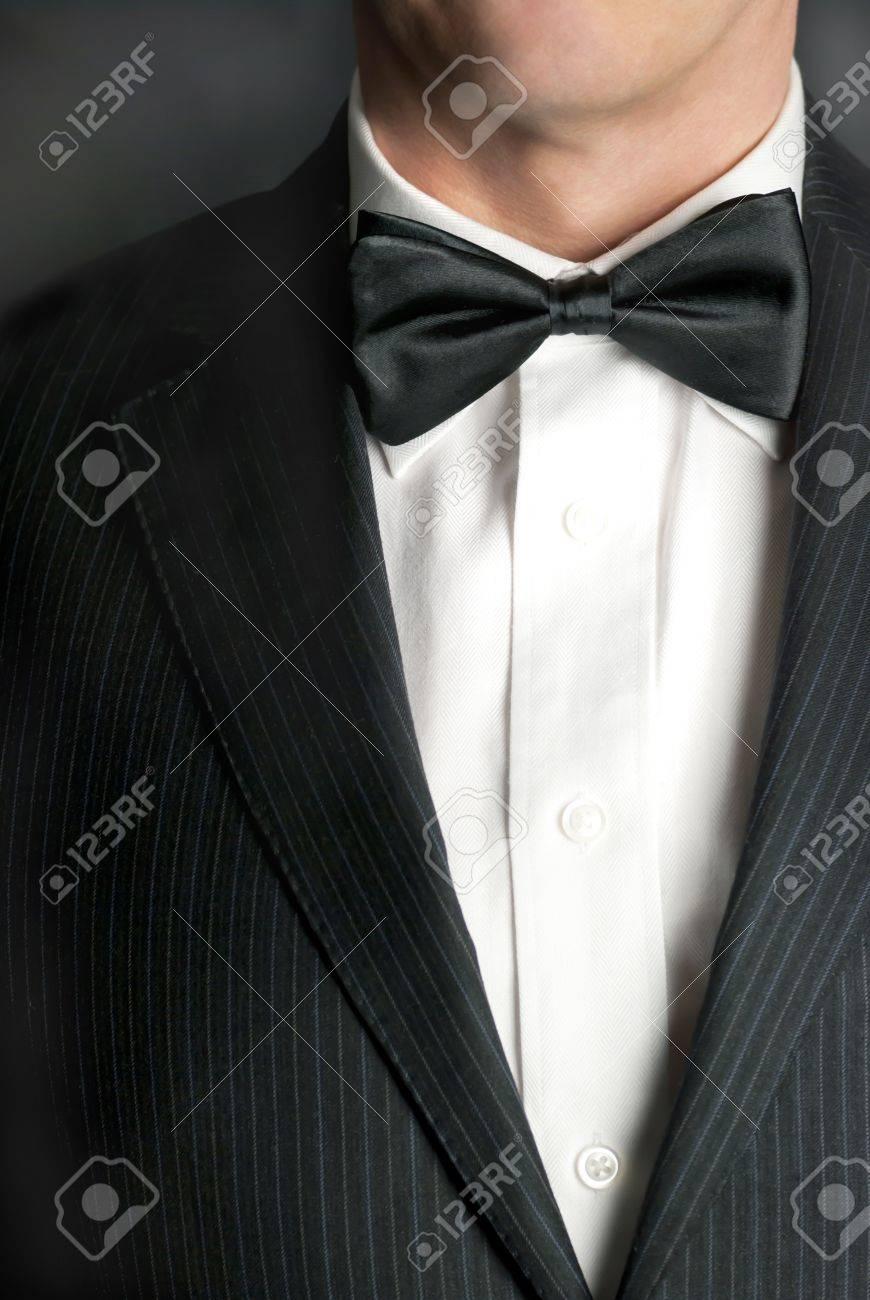 A close-up shot of a man wearing a tux. - 8956519