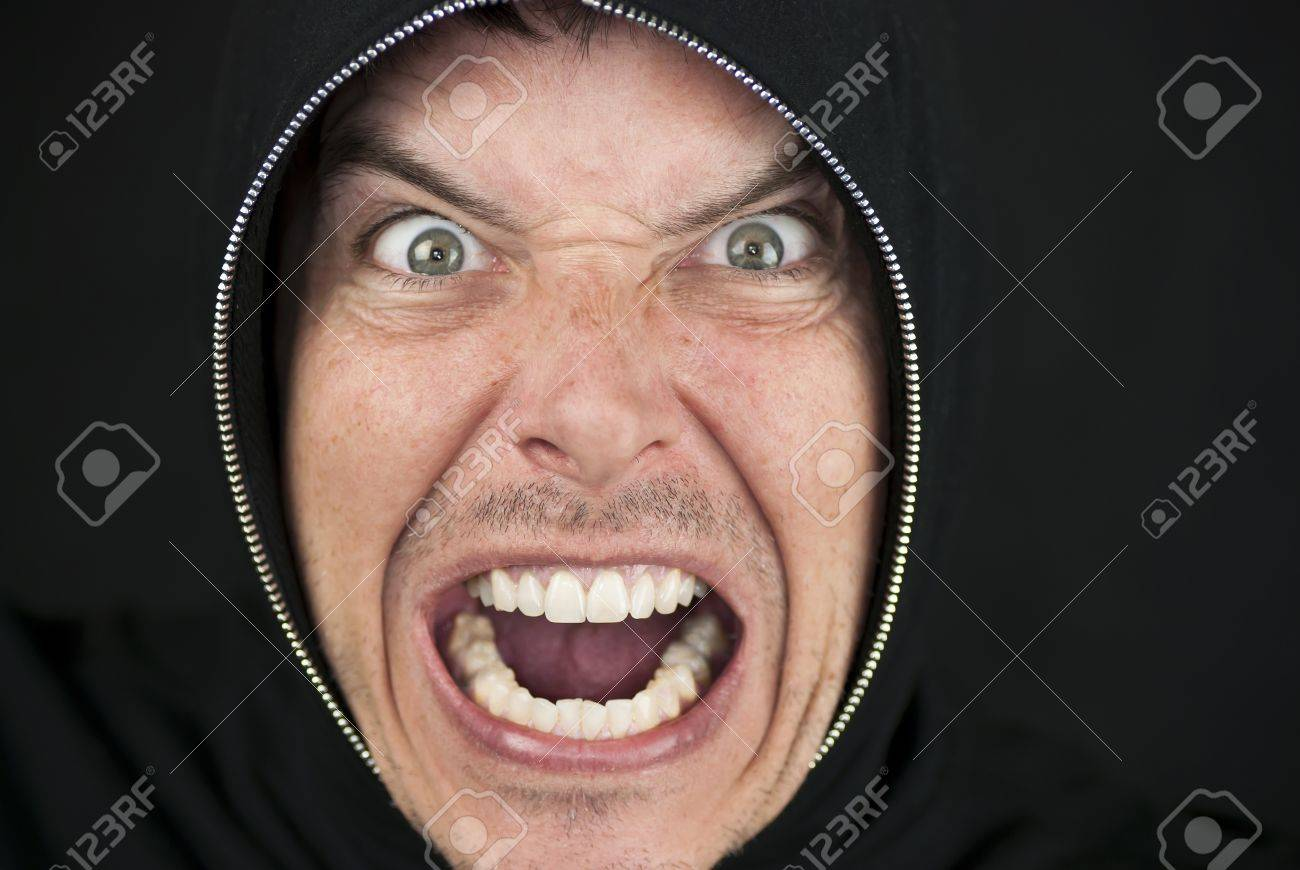 Close-up of an furious man looking to camera. - 9585156