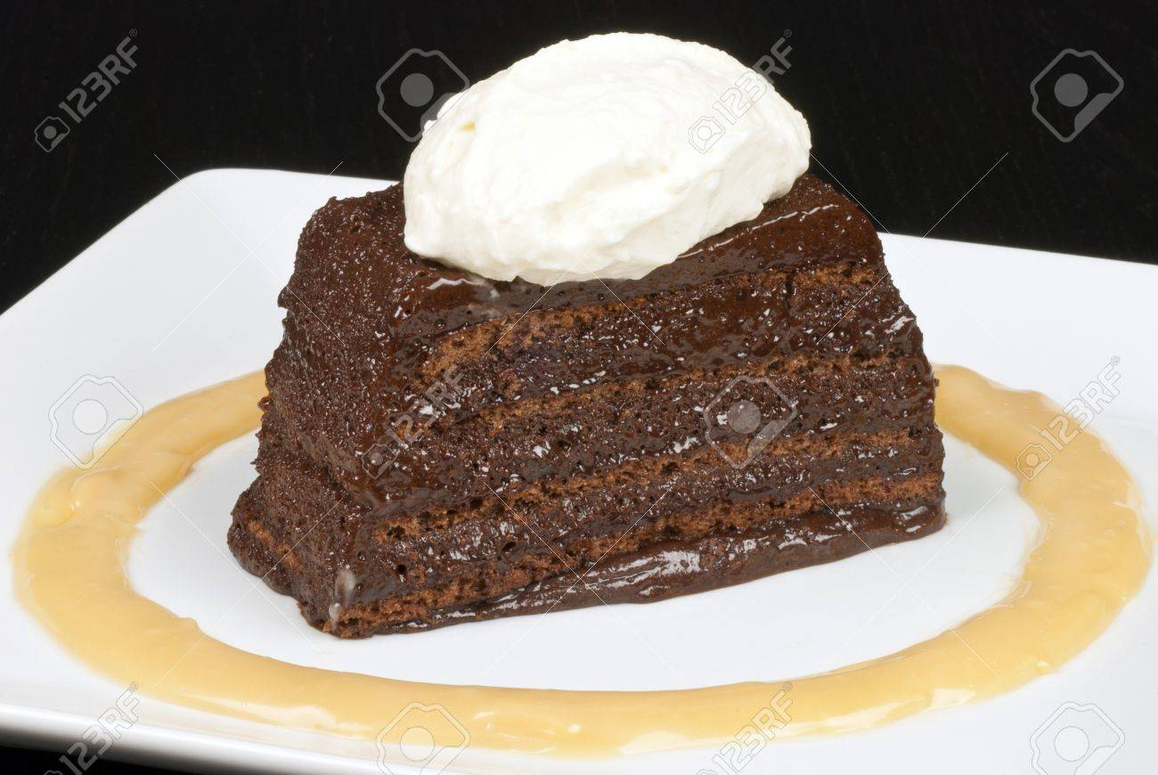 Close-up of a chocolate marquise with a white chocolate marscapone and butterscotch sauce. - 11369403