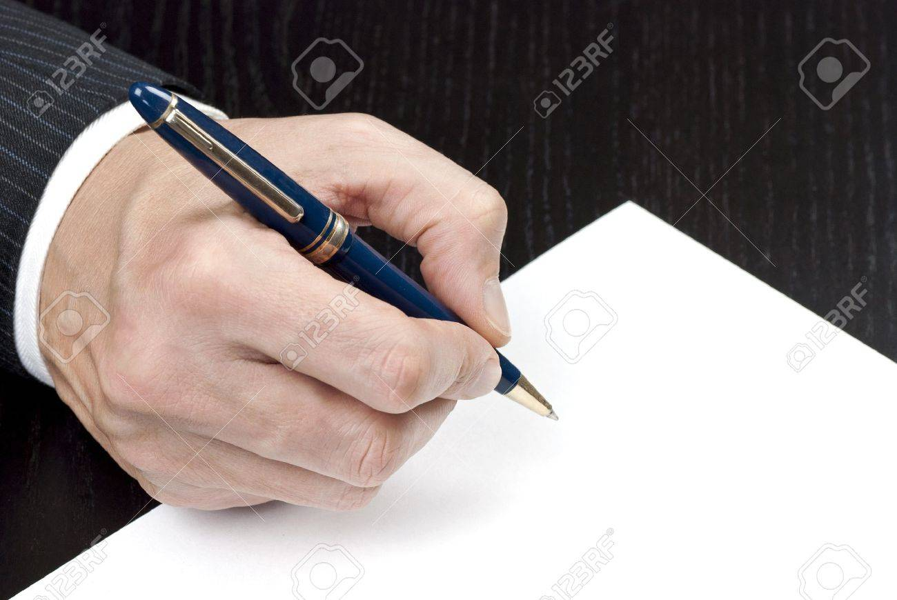 Close-up of a businessman signing a contract. - 11675123