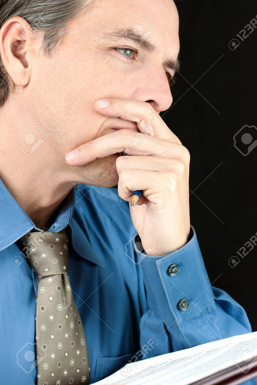 Close-up of a thoughtful businessman contemplating a document Stock Photo - 14346700