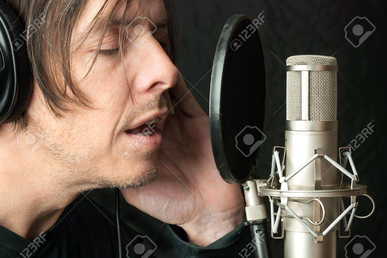 Close-up of a serious man recording vocals in a sound studio. Stock Photo - 14900647