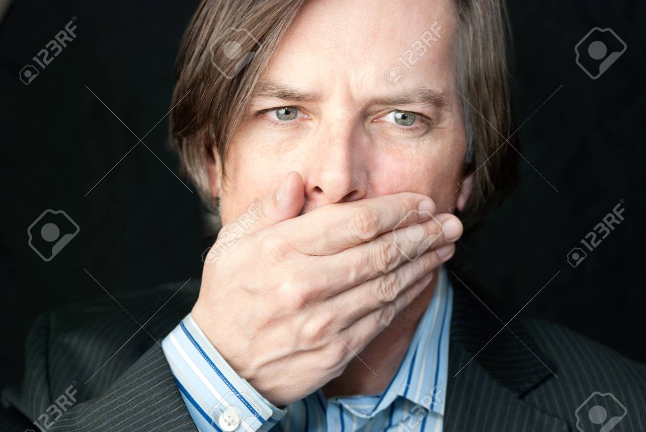 Close-up of a shocked businessman covering his mouth. Stock Photo - 14900685