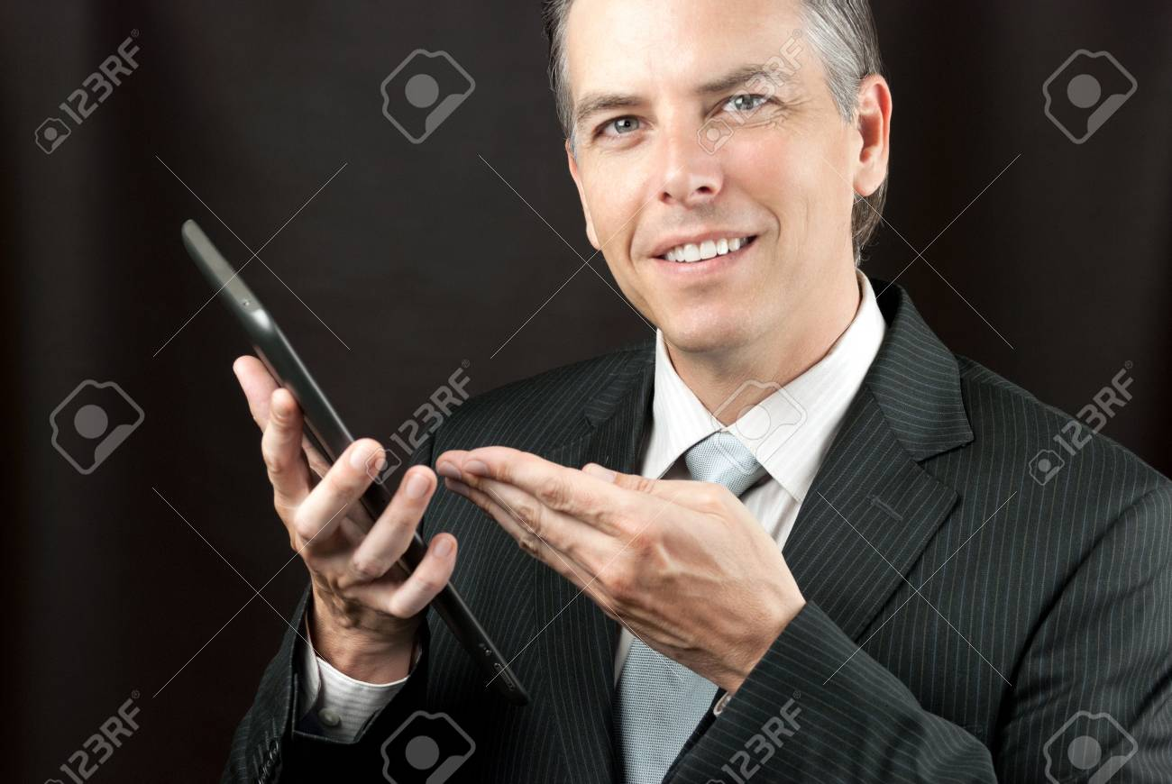 Close-up of a businessman showing his tablet. - 15693334