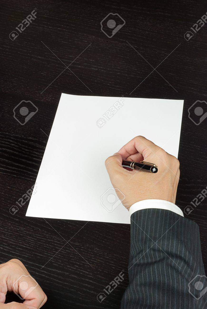 Close-up of a businessman writing, shot from above - 15881349
