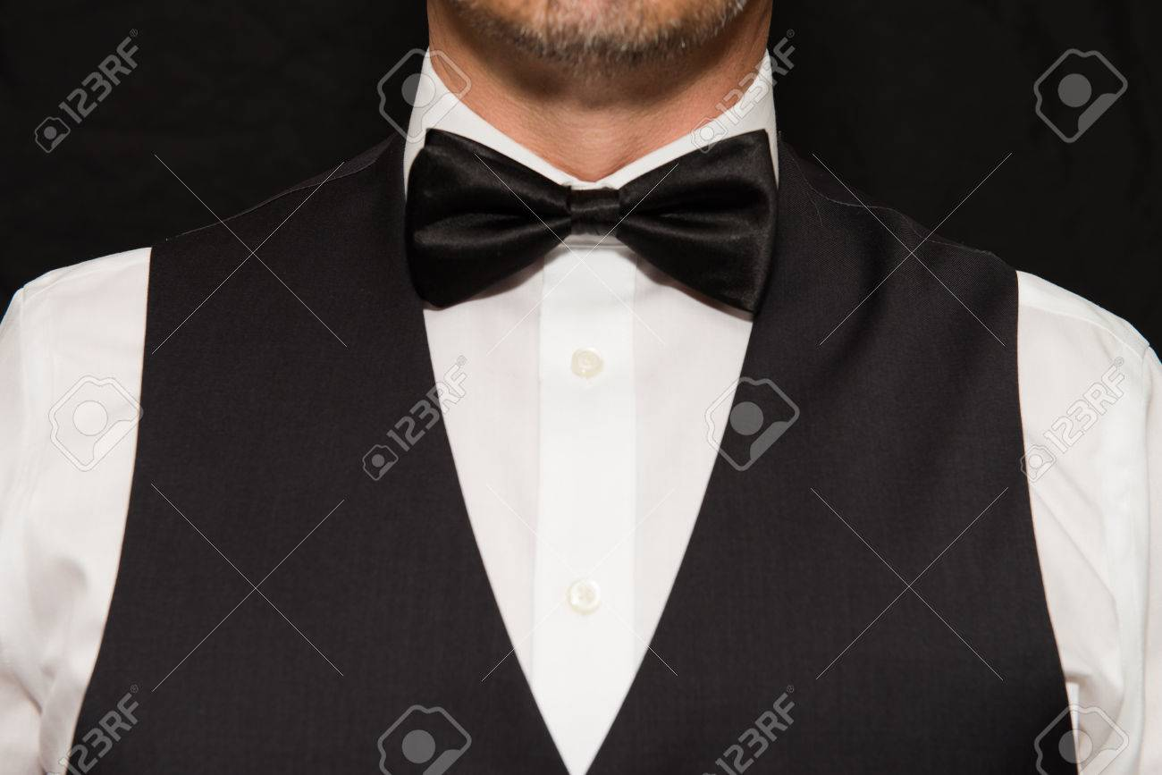 Close-up of gentleman wearing a waistcoat and bowtie. - 45665898