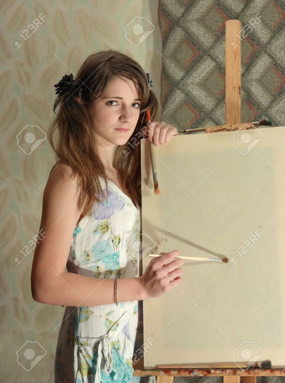 banque dimages beaut ado fille peinture sur toile blanche