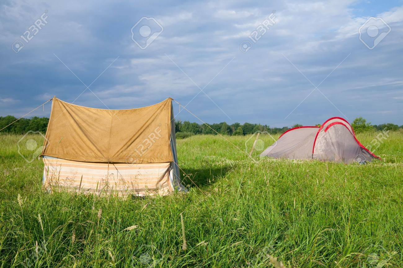 Two tourist tents on medow against nature Stock Photo - 5208611