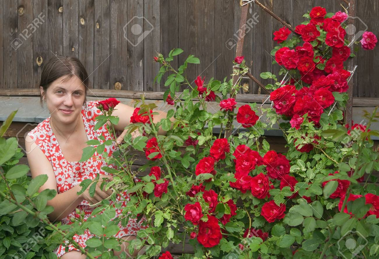 Young smiling girl florists working in the garden Stock Photo - 5437587