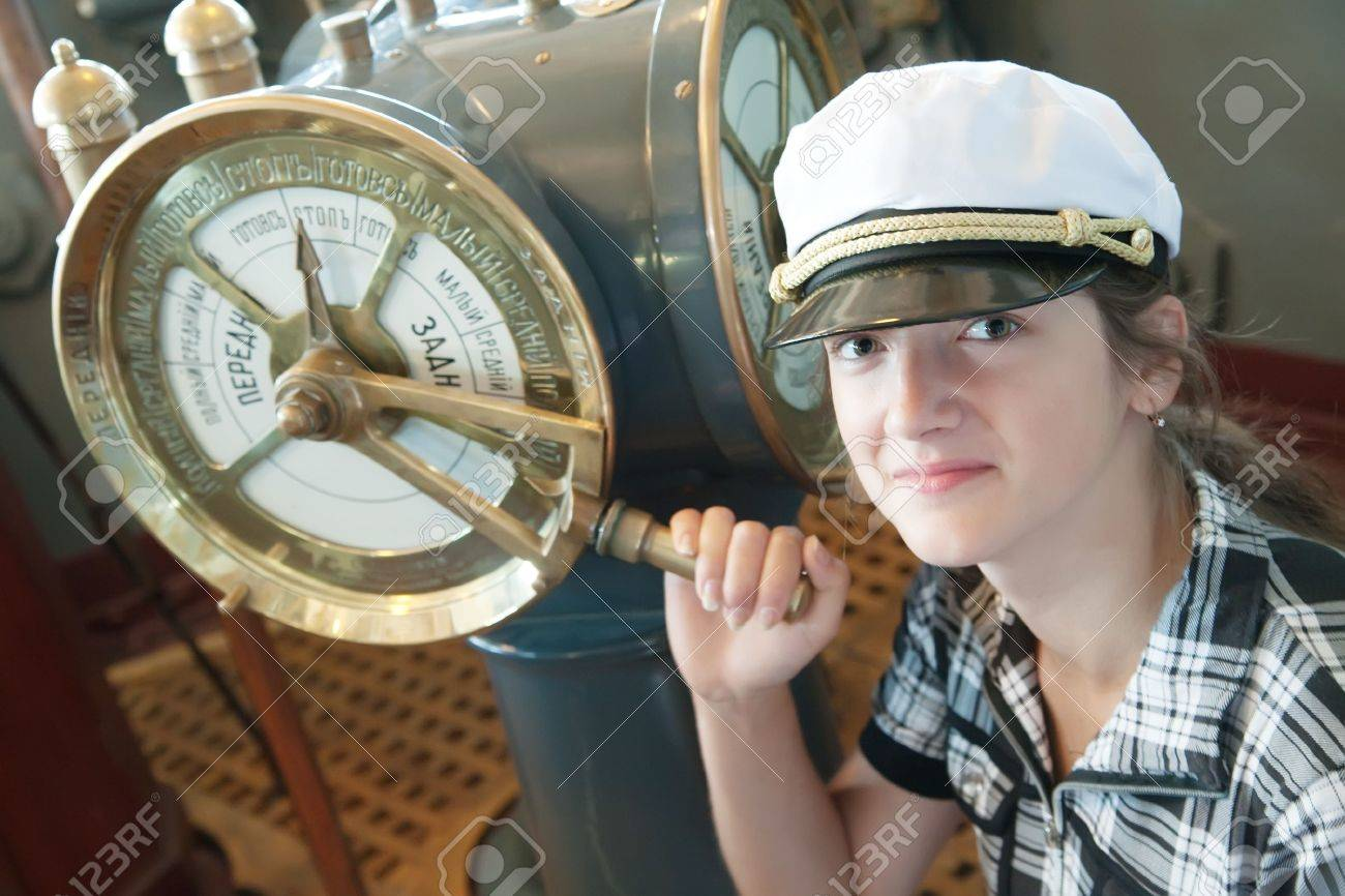young girl near  speed telegraph transmitter on old cruiser Stock Photo - 5918099