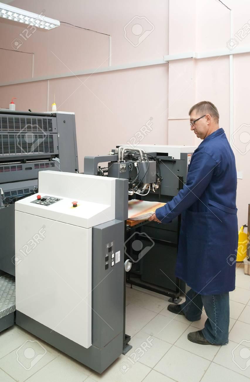 Printer working at his new offset machine Stock Photo - 6064077