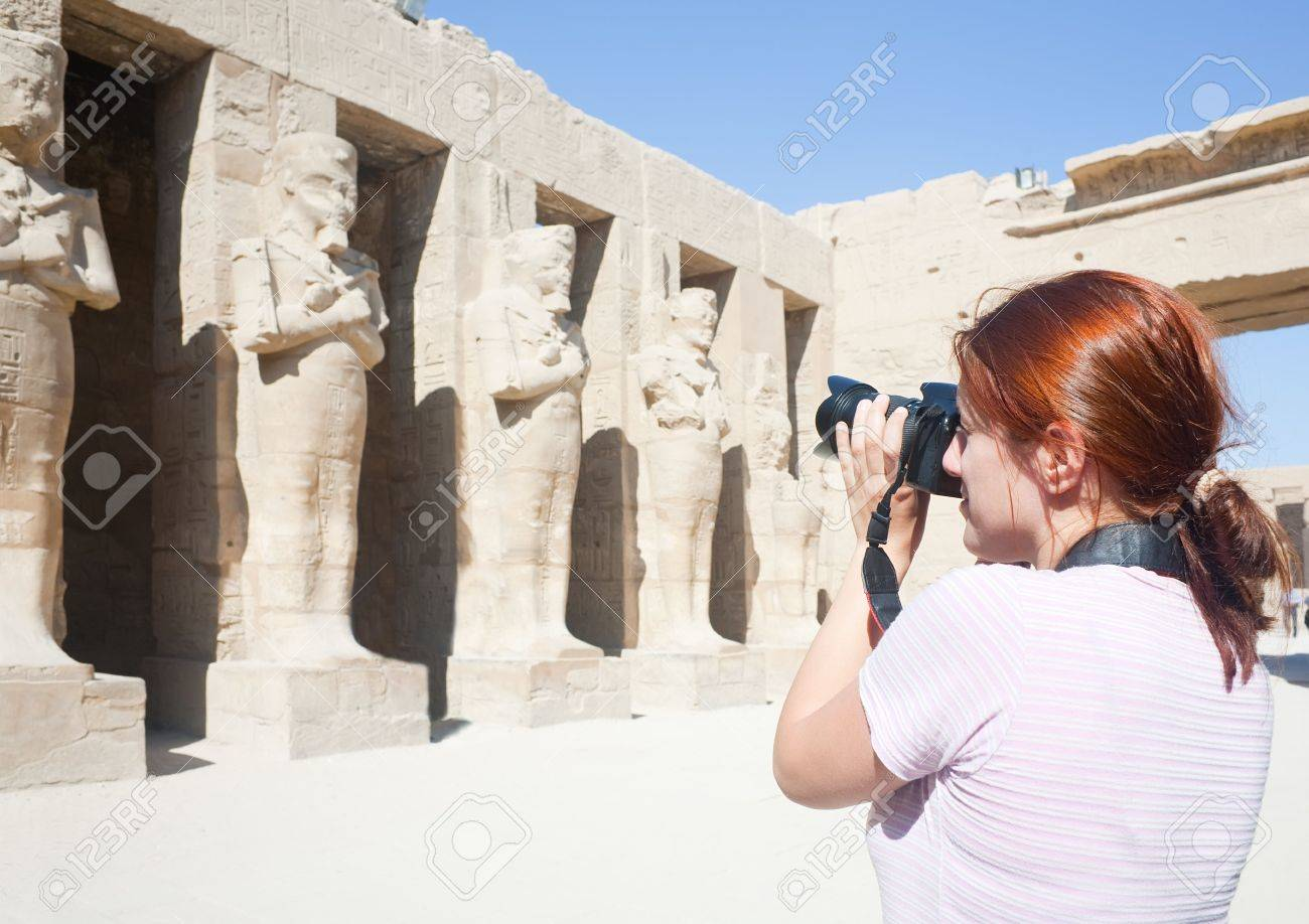 Girl is photographing an ancient statues in Karnak temple, Luxor, Egypt Stock Photo - 6276052