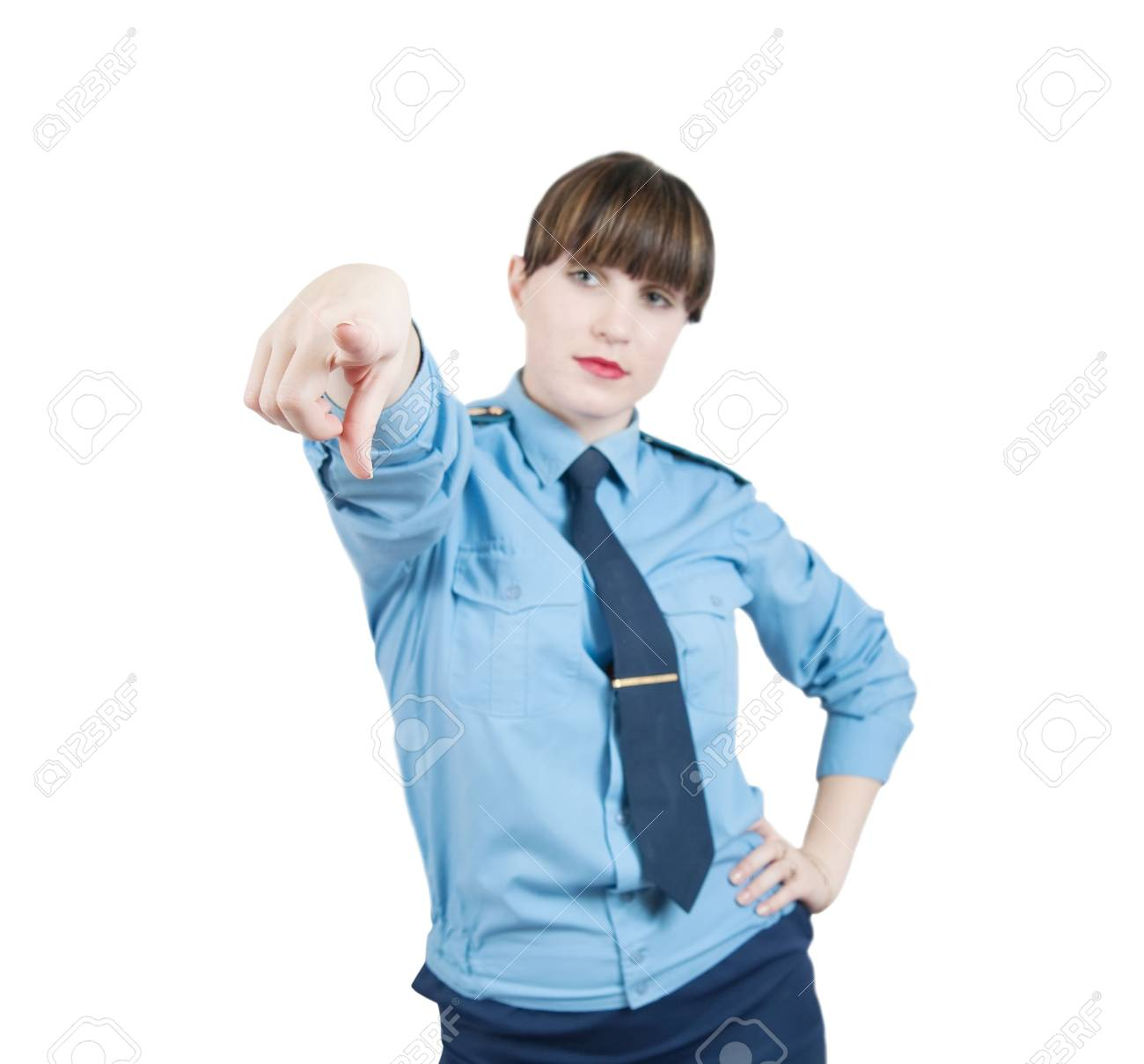 pointing woman in uniform. Focus on hand Stock Photo - 6346281