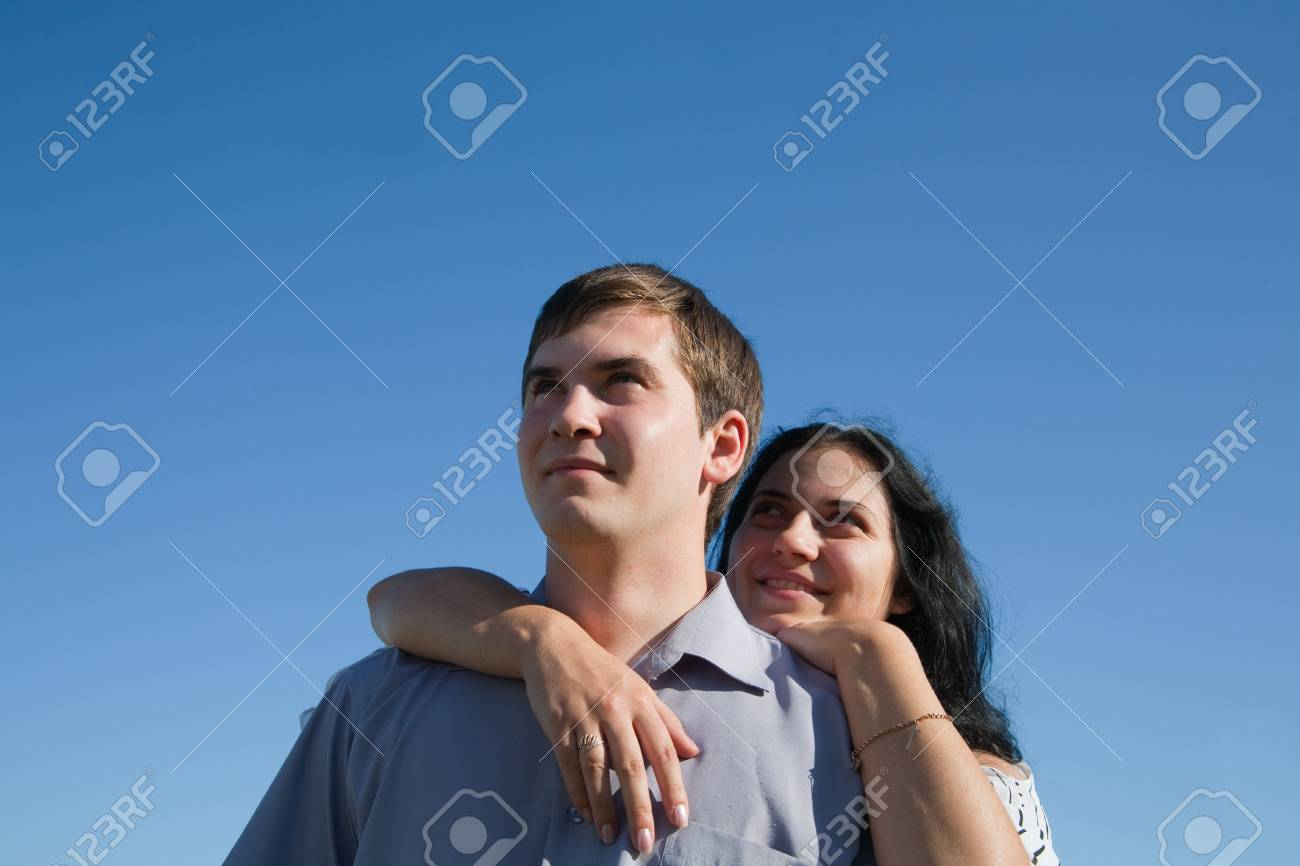 happy couple smiling outdoors against blue sky Stock Photo - 6857987