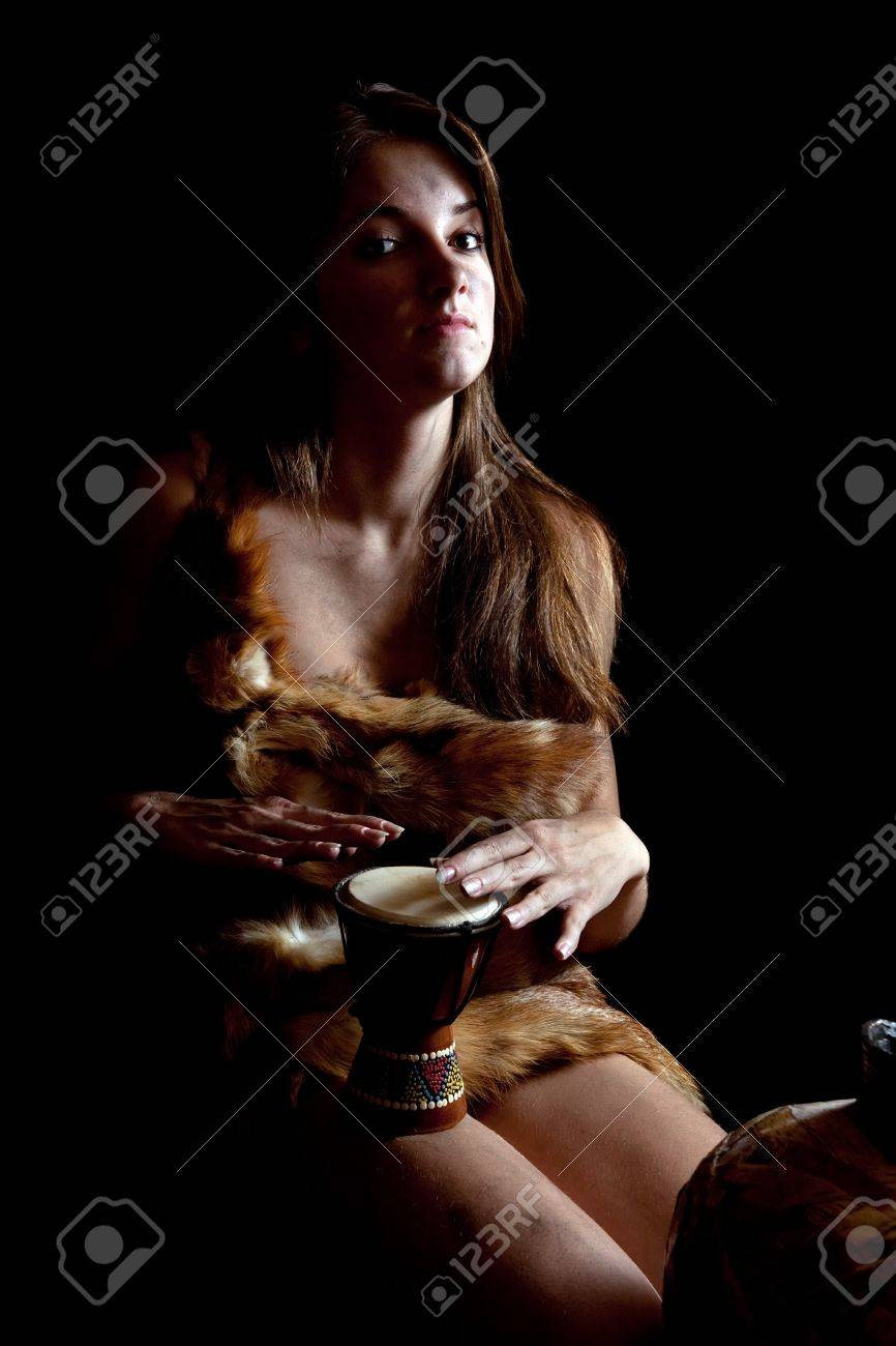 Female cave-dweller in foxcase with  tambourine at dark Stock Photo - 6877467