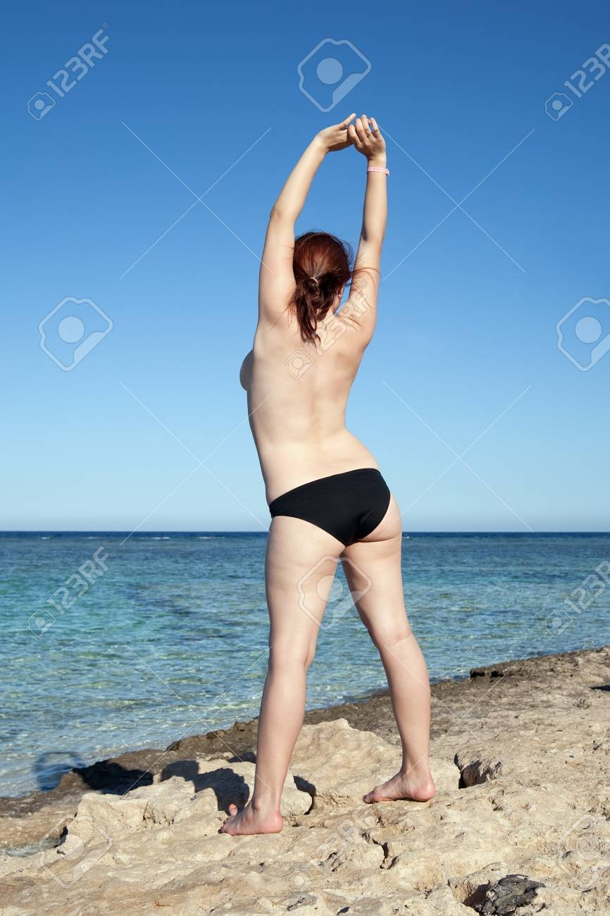 Naked girls on nudist beaches Topless Girl Enjoying The Stone Beach On Nice Day Stock Photo Picture And Royalty Free Image Image 7065983