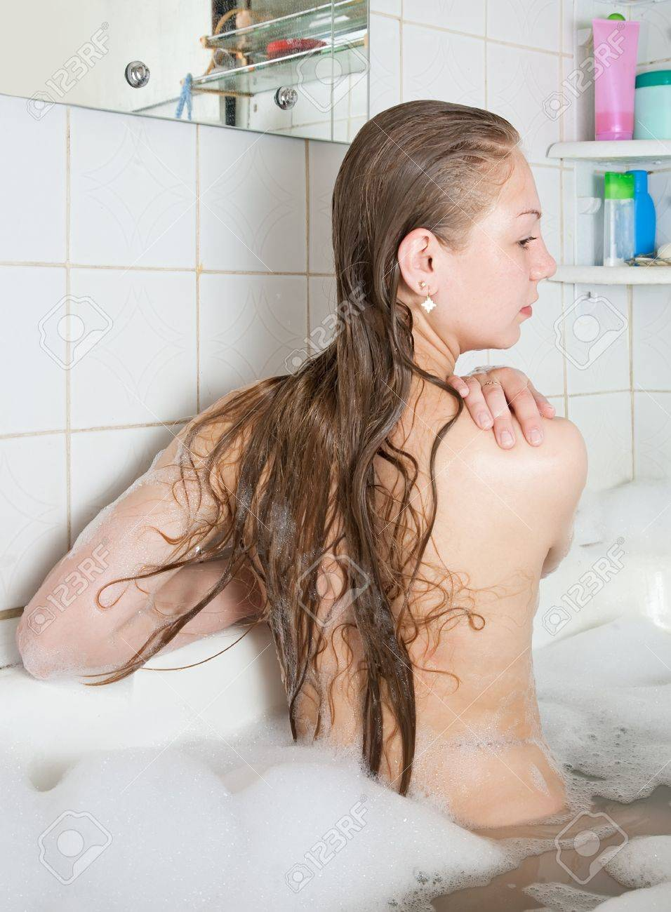 Rear view of girl sitting in bath Stock Photo - 7092200