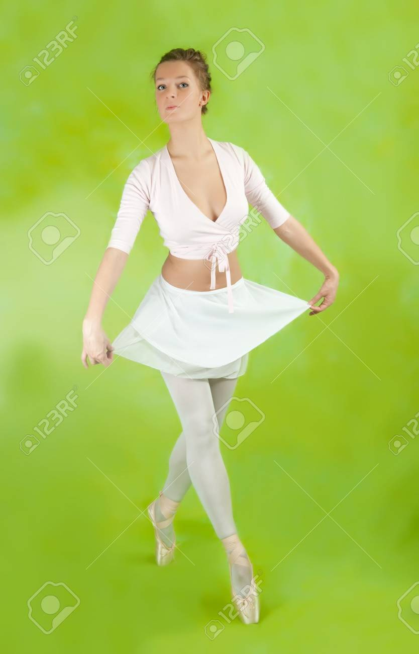 Young female ballerina  performing a dance over green background Stock Photo - 7364467