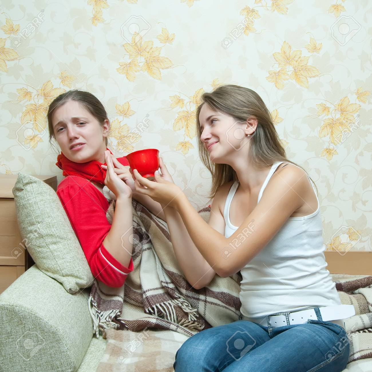 girl gives a cup to sick girl Stock Photo - 7375207