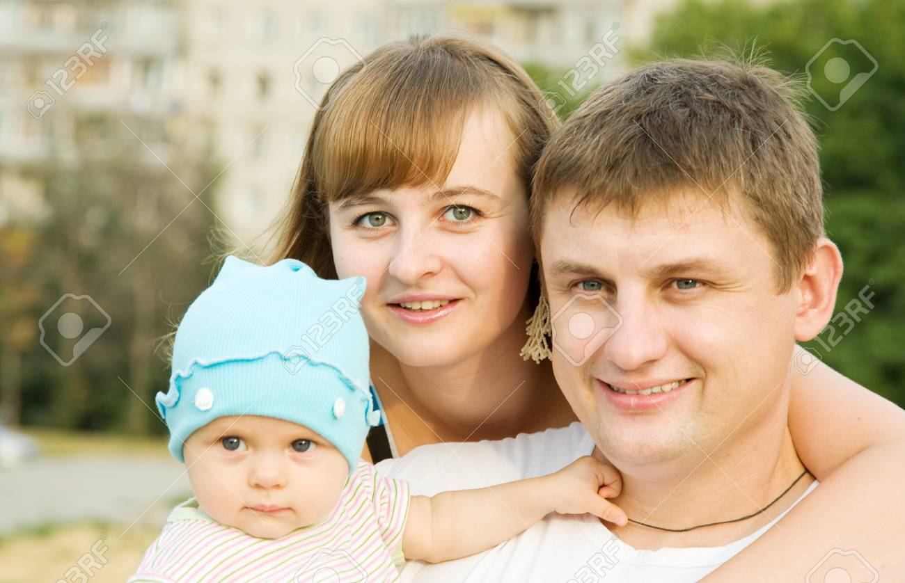 portrait of  happy family of three at city park Stock Photo - 7619382