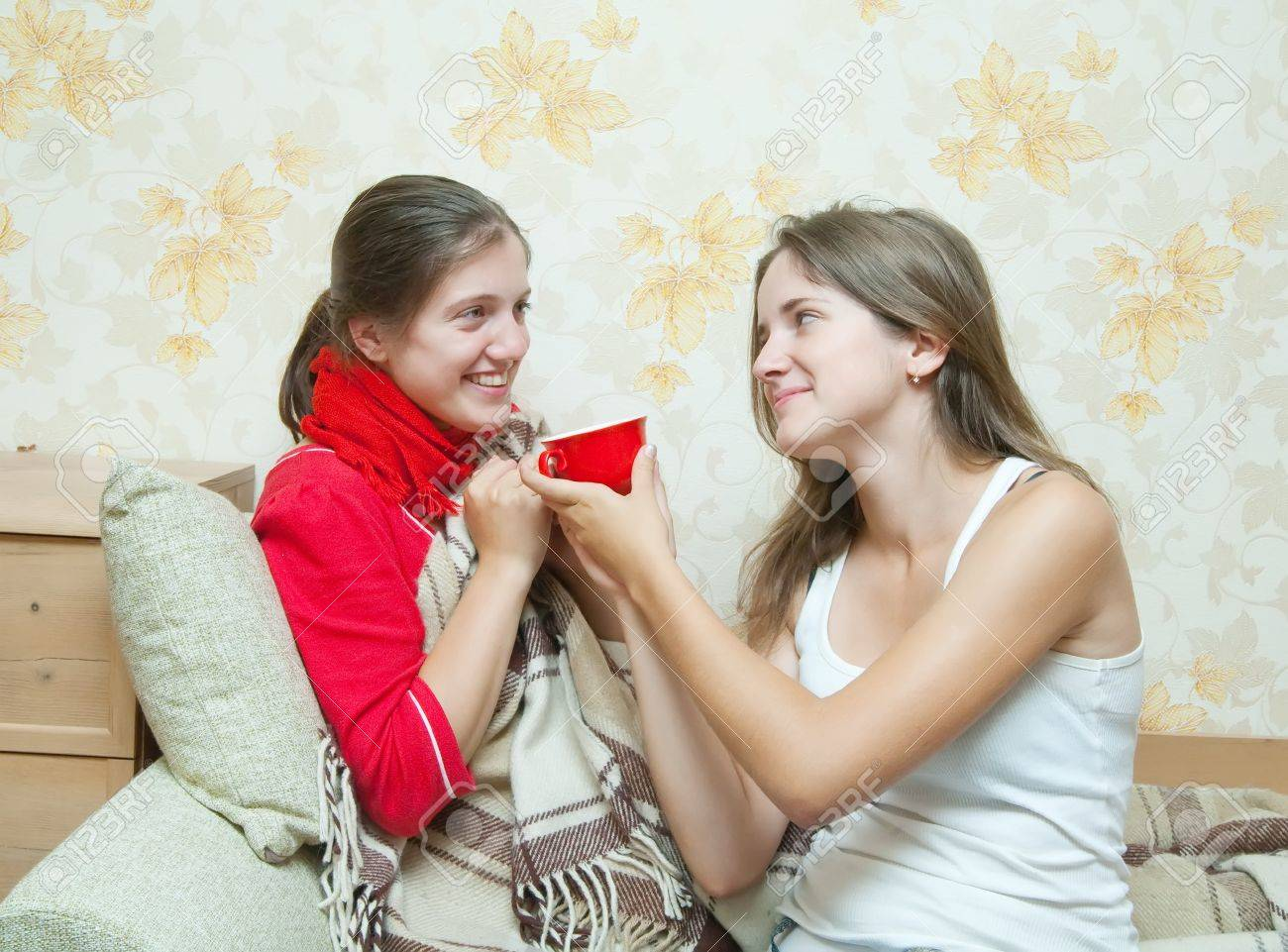 girl gives a cup to unwell girl Stock Photo - 7644570