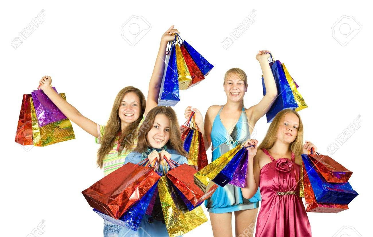 Happy girls with shopping bags. Isolated over white background Stock Photo - 7777238