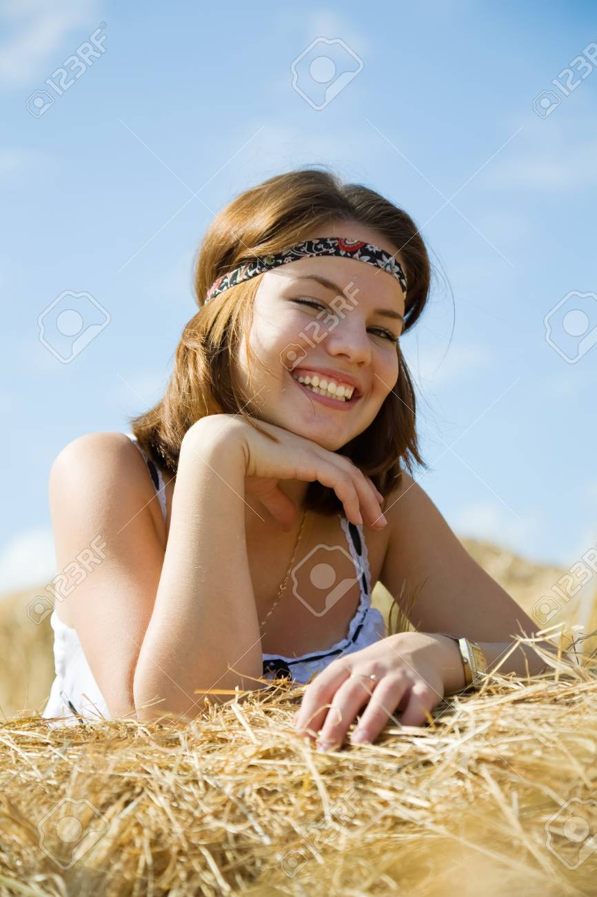 Country girl on fresh hay in summer Stock Photo - 7873321