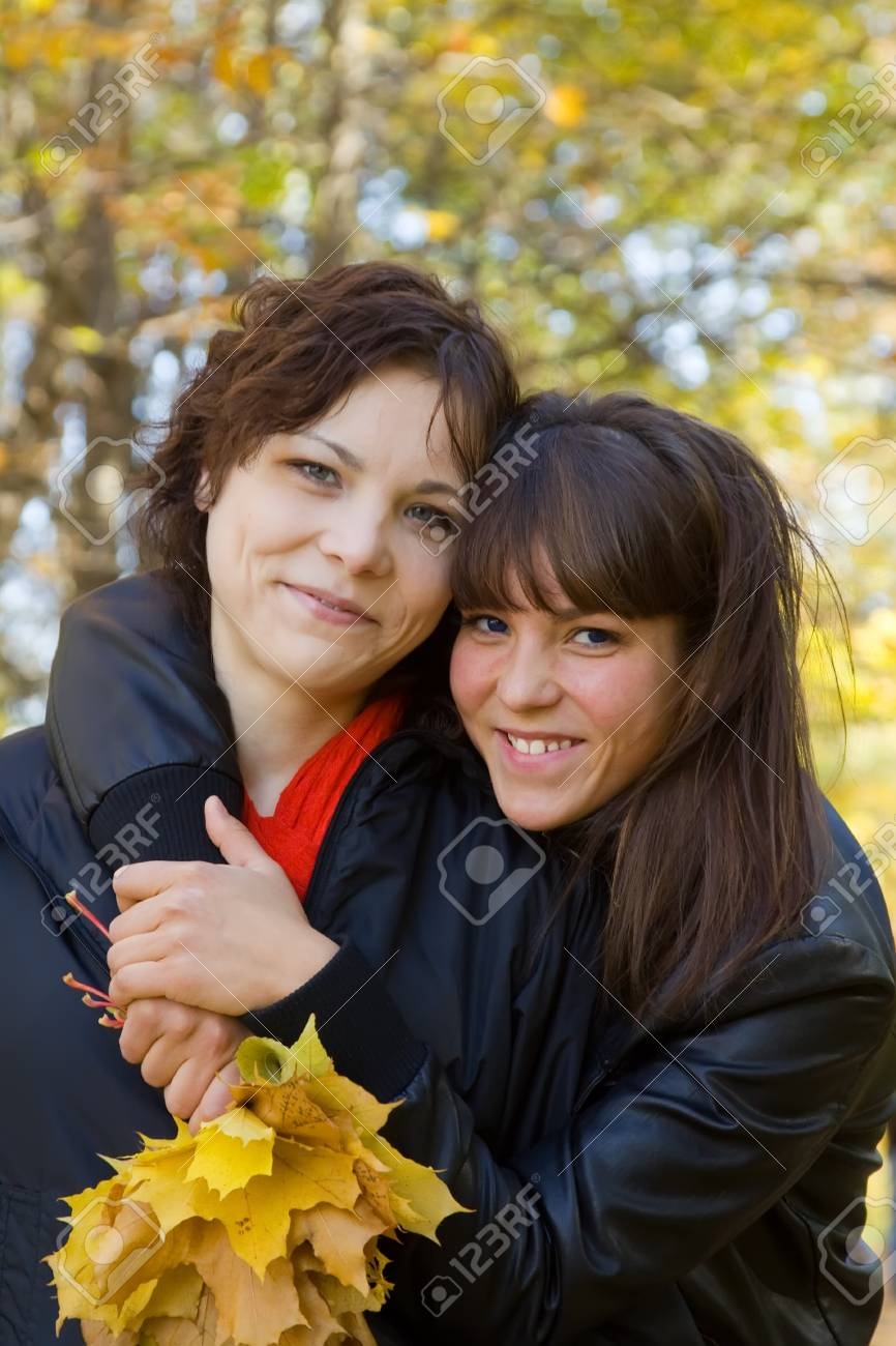 Two pretty girls  standing outdoors in autumn Stock Photo - 8000846