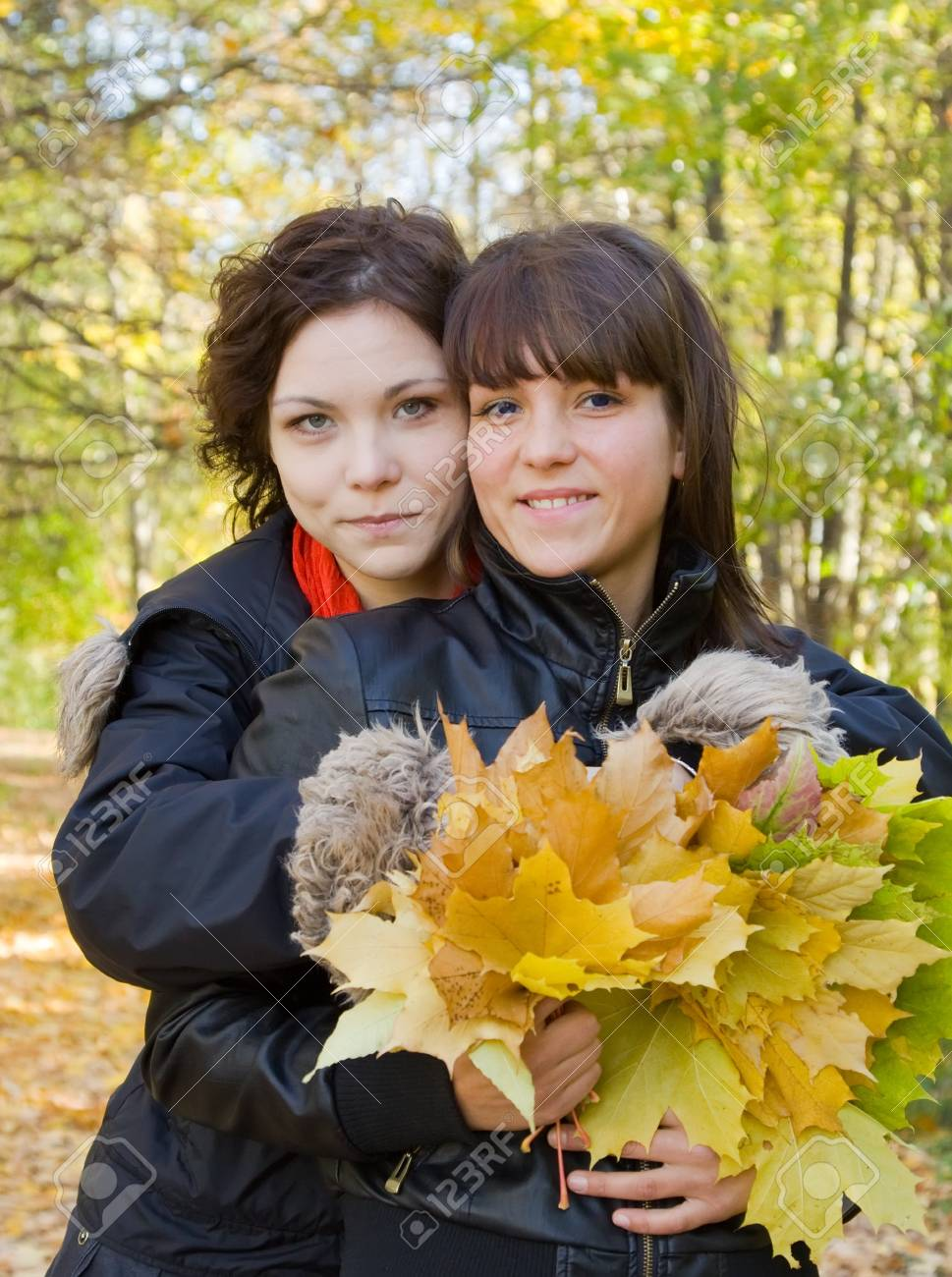 Portrait of two pretty girls in autumn park Stock Photo - 8000797