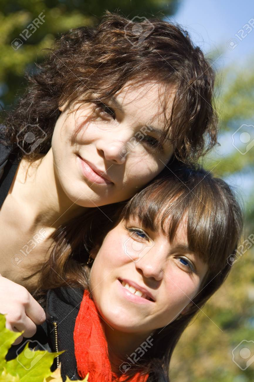 Portrait of two pretty girls in autumn park Stock Photo - 8000897