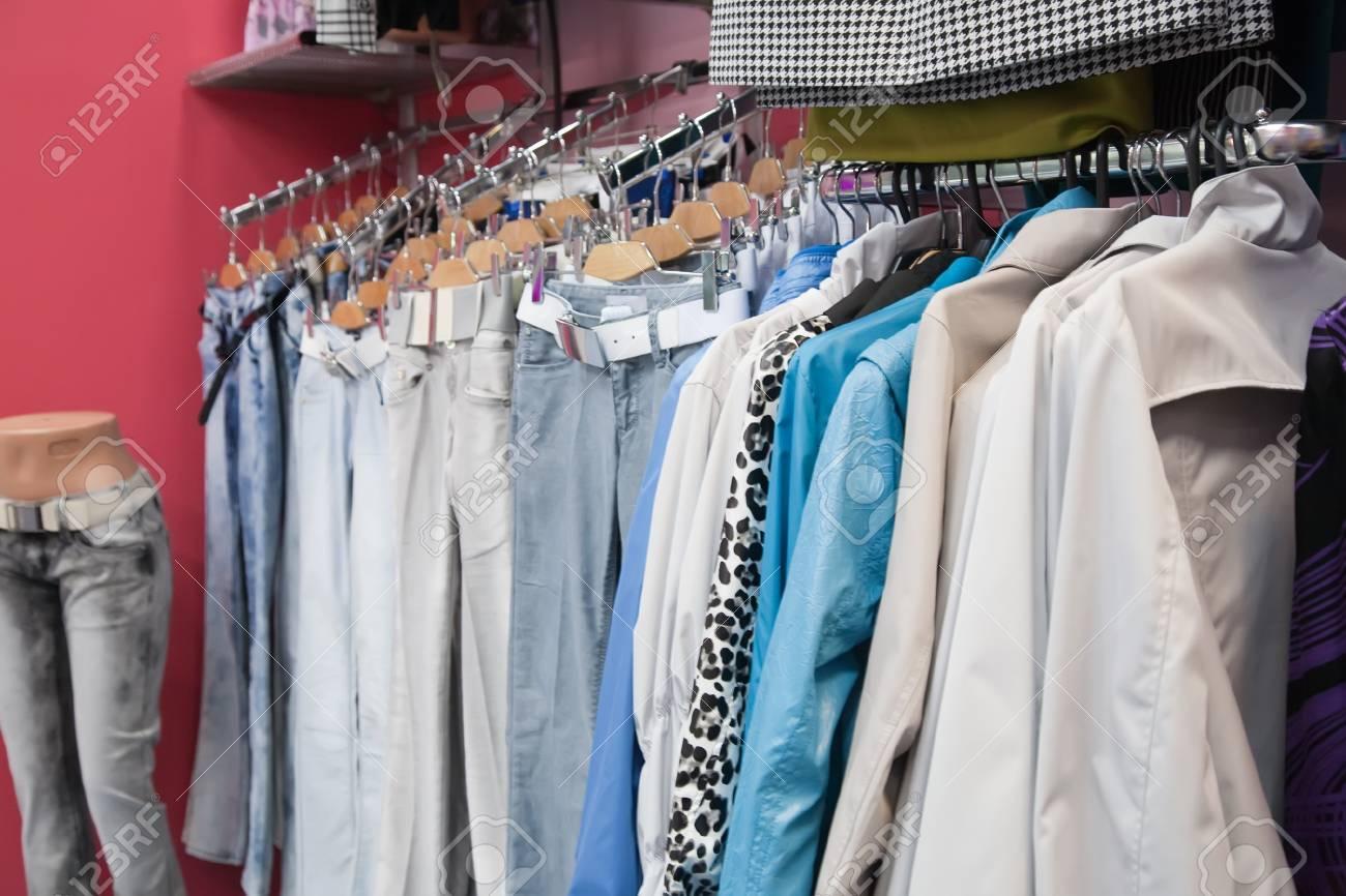 Many dresses on raks at clothes shop - 8071664