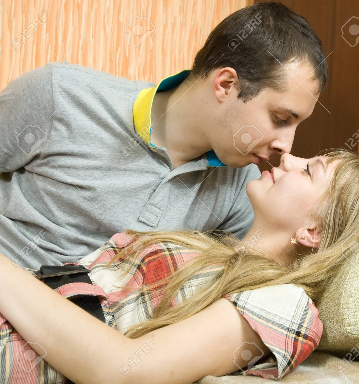 Young couple in love on sofa in  home interior Stock Photo - 8591444