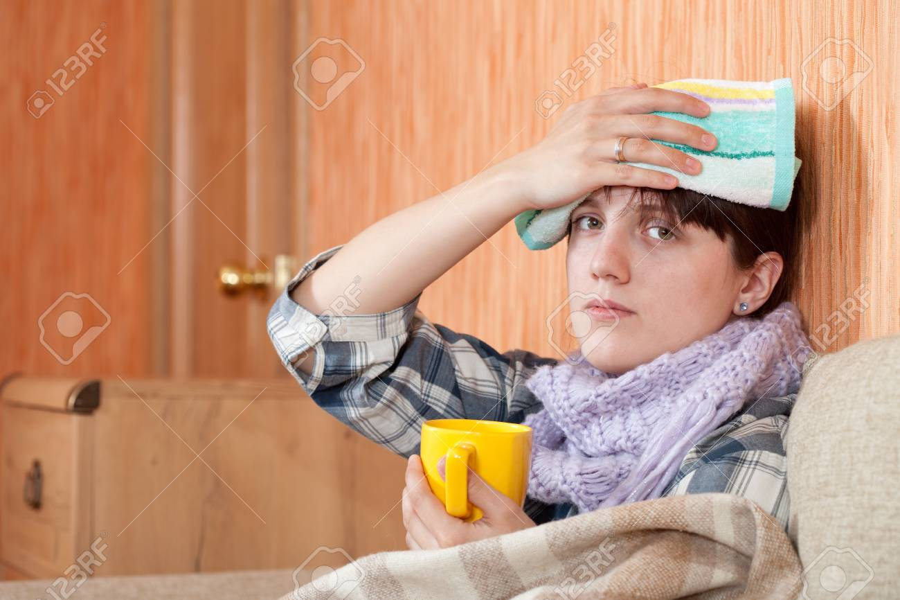 Young illness woman drinking hot tea in blanket Stock Photo - 9167464