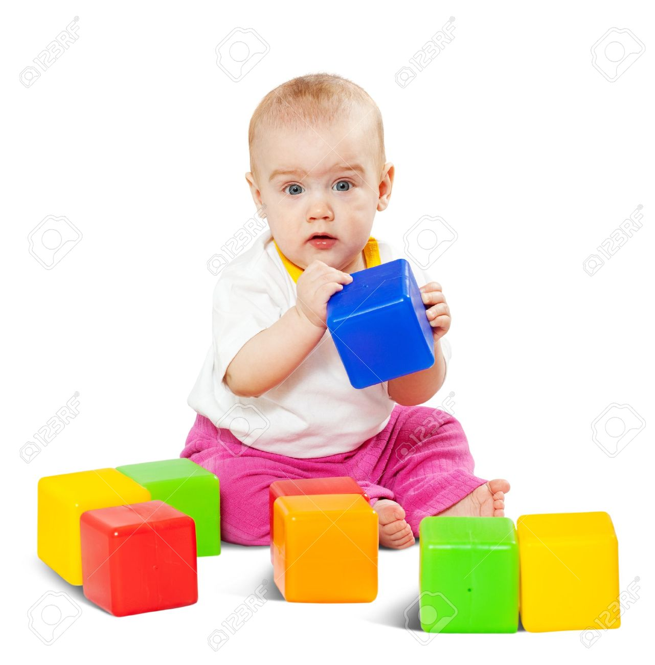 Happy baby plays  with toy blocks over white background Stock Photo - 9248865