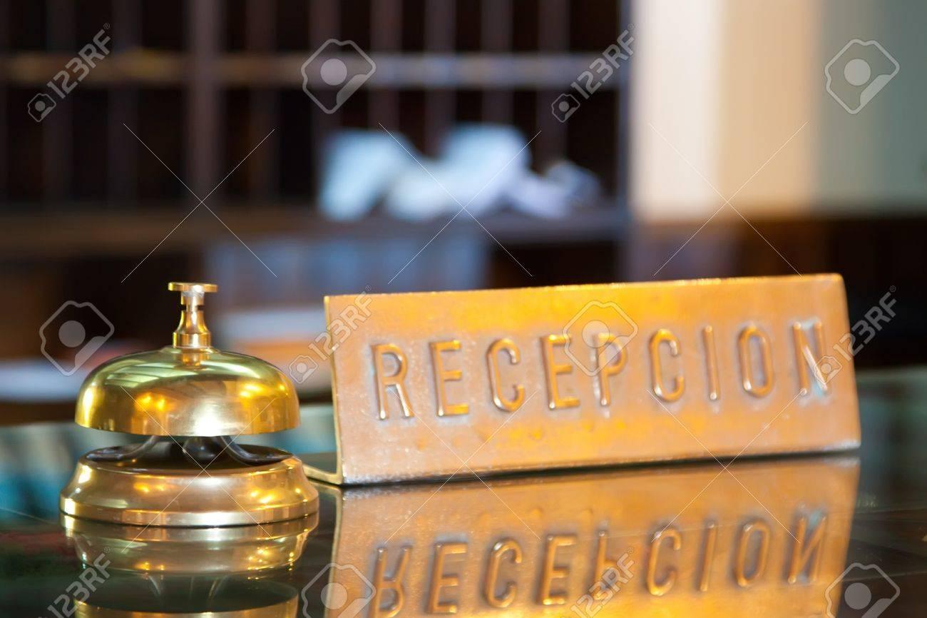 Golden bell on  reception desk in hotel Stock Photo - 9385224