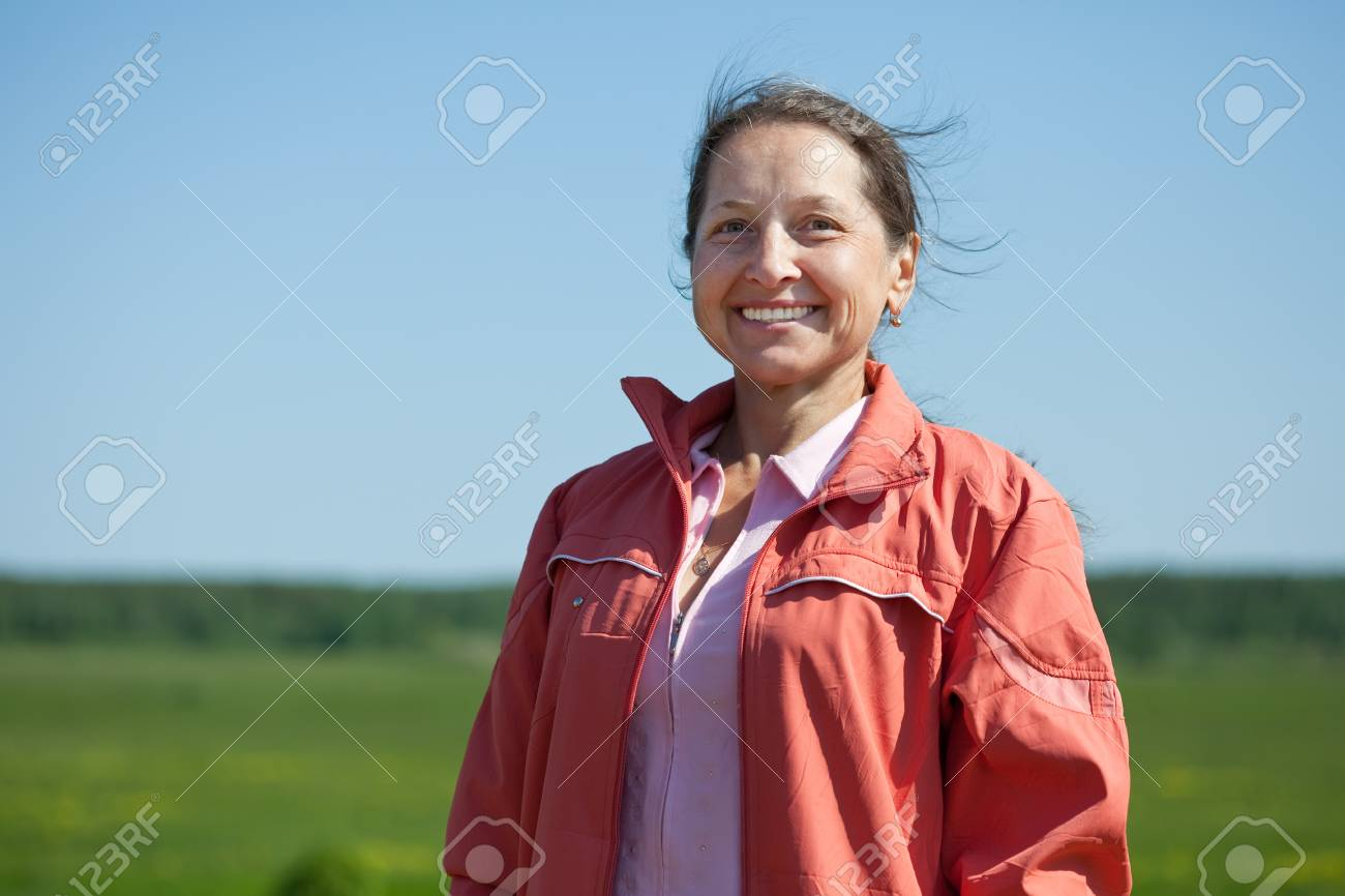 Outdoor portrait of smiling mature woman Stock Photo - 9853916