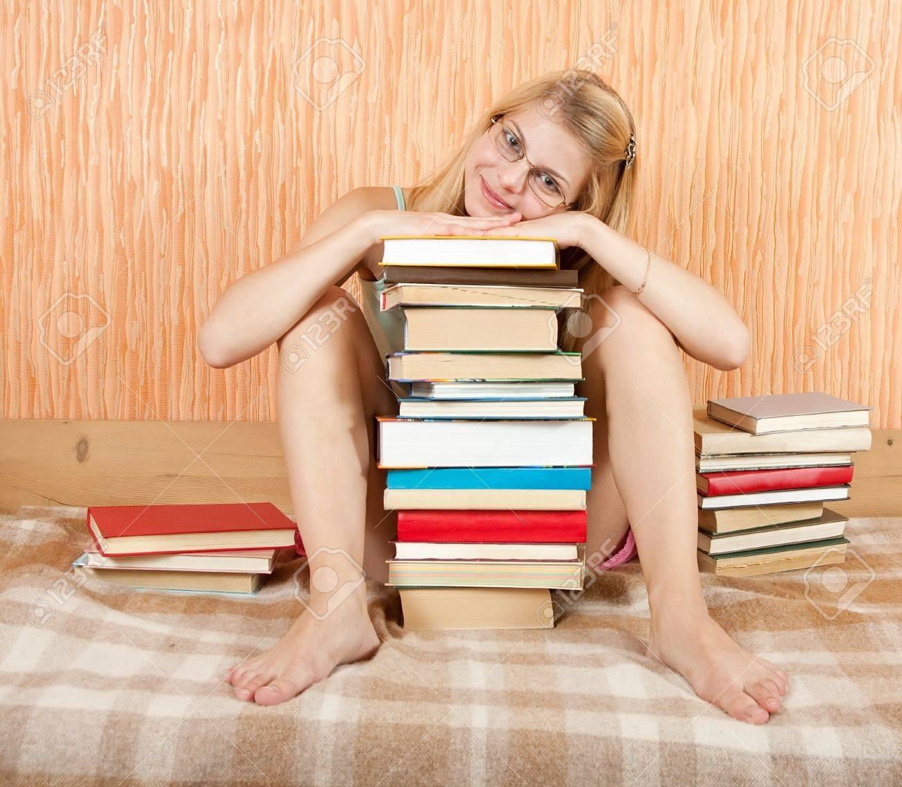 pretty female student with books on sofa at home Stock Photo - 9854244