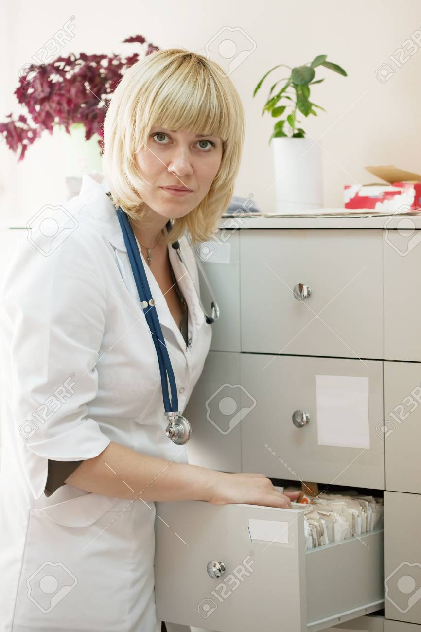Female doctor searching for patient's records in clinic Stock Photo - 9855061